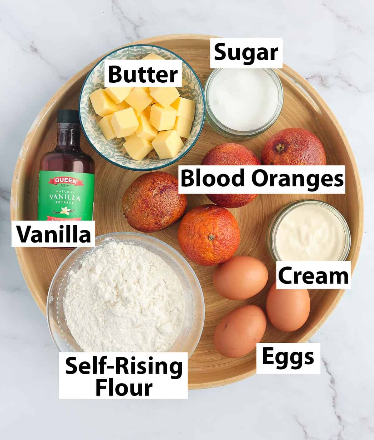 Recipe ingredients in a round wooden tray.