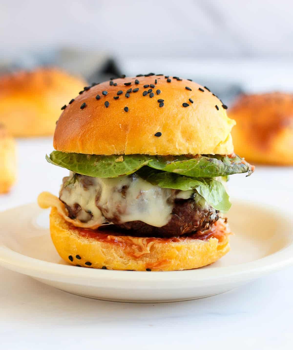 Plated Hamburger made with a sweet potato bun.