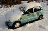 Abandoned Snow-Covered Car