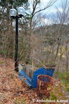 Abandoned Lamps And Rusty Trash Basket