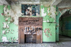A hand painted mural decorates a day room, above a fireplace that was used to fight the cold during a disastrous heating failure in 1917.