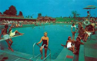 Postcard of outdoor pool during peak use