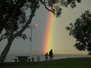 Rainbow_At_Maraetai_Beach_New_Zealand