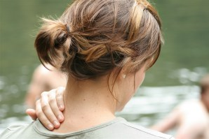 Image of woman massaging her neck.