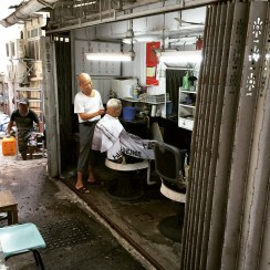Tiny barbershop on Shing Wong Street
