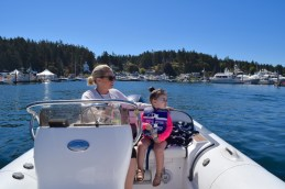 My daughter and I at Roche Harbor this past summer, buzzing around on the dinghy