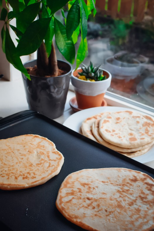 The flatbreads will appear like this for the for the side first cooked, and the second side will have more brown spots and less of a golden rim as they bubble a little while cooking.
