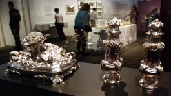 these showy serving platters adorned with silver rabbits and heads of cauliflower, and a pair of sugar castors from 1743.
