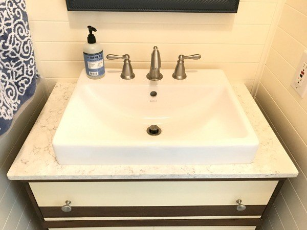 Farmhouse sink and moen faucet. Bathroom Makeover Reveal. These 5 steps took our bathroom from blah to charming Farmhouse-style.