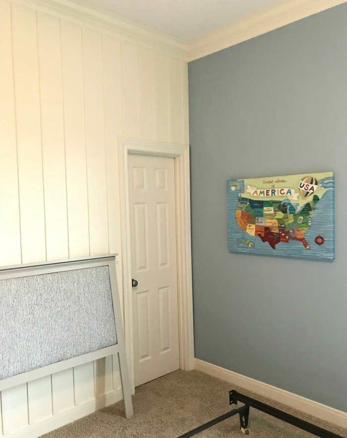 Corner of the room. White DIY Board and Batten Wainscoting with lattice. Wainscoting ideas with classic style and Farmhouse woodworking charm.