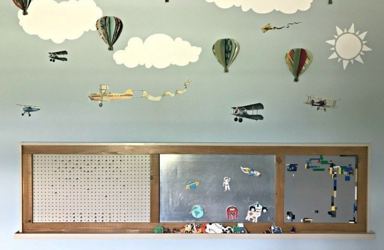The full board with the planes, balloons, and clouds I added. Build a fun DIY Modern Farmhouse Kids Activity Wall Board. With 20 Ideas for board options that work for kids, teens, and adults. #ModernFarmhouse #KidsFurniture #DIYKids #AbbottsAtHome