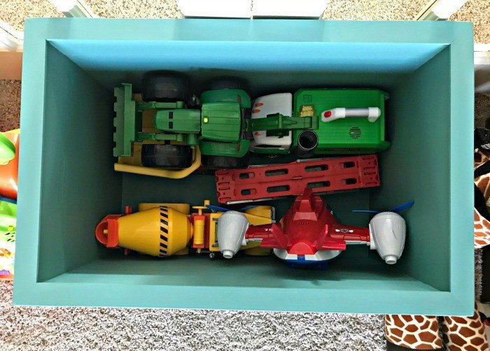 6 of those large kids toys in the bottom of the crate and there's still tons of room. Build a Modern Farmhouse DIY Wooden Toy Storage Box for all of those kids toys. Makes a beautiful throw pillow and blanket box in a Living Room or catch all storage box for teens too! #AbbottsAtHome #StorageBox #ToyBox #DIYStorage