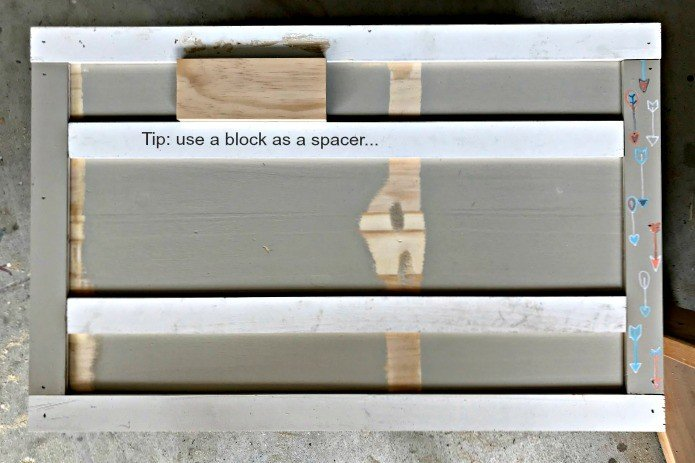 DIY Tip: Use a wood block as a spacing guide for trim. Build a Modern Farmhouse DIY Wooden Toy Storage Crate or Box for all of those kids toys cluttering up your house. Makes a beautiful throw pillow and blanket box in a Living Room or catch all storage box for teens too! #AbbottsAtHome #StorageBox #ToyBox #DIYStorage