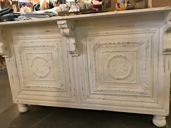 A white distressed bar front with tin tiles. A few more Round Top Shopping Trip Tips and some photos from the Junk Gypsy Headquarters. A shopping trip to Round Top and Waco would make a perfect weekend, guys! #AbbottsAtHome #RoundTopTexas #JunkGypsy #GirlsWeekend