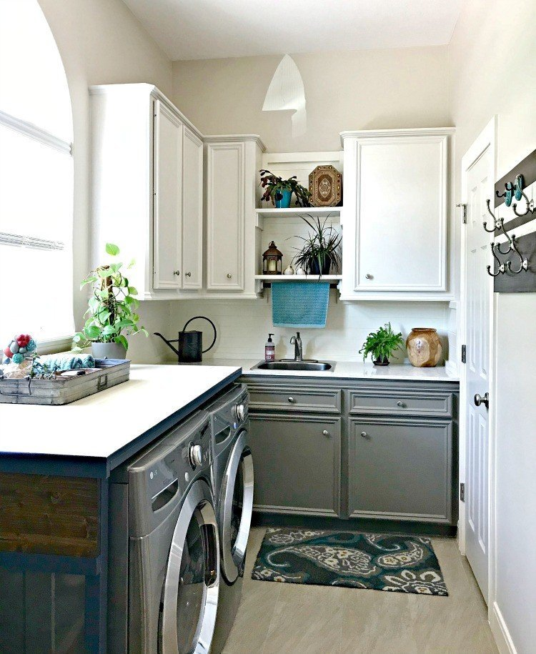 Behr's Sandstone Cove on the walls and upper cabinets, Behr's Squirrel on the lower cabinets. This Modern Farmhouse DIY Laundry Room Makeover Ideas post is full of Before & After Makeover Photos, budget-friendly DIY ideas, and Laundry Room decor. #LaundryRoom #BeforeandAfter #AbbottsAtHome