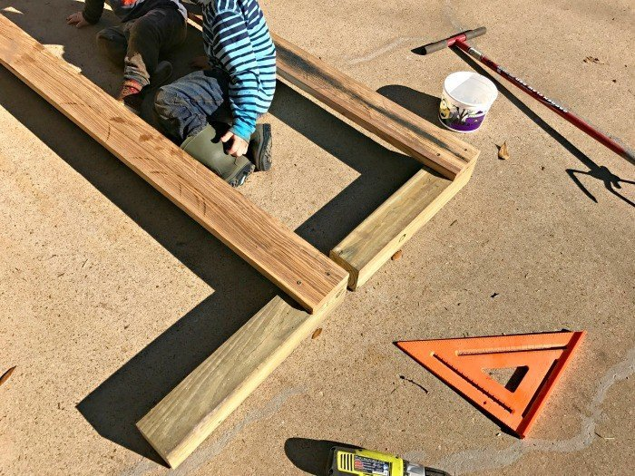 Start by screwing the frame together. Build this DIY Rustic Farmhouse Outdoor Bench with just a drill and a saw. This is a great 2x4 bench project. #AbbottsAtHome #DIYBench #DIYFurniture #2x4bench