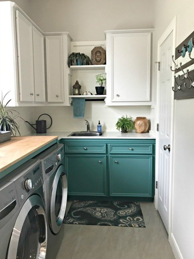 DIY Chalk Painted Cabinets in Magnolia Homes by Kilz color Spontaneous and Behr's Sandstone Cove. A fresh Modern Farmhouse look using teal, wood, and lots of white. This Modern Farmhouse Small Laundry Room Design is full of easy DIY projects and affordable decor. #LaundryRoom #ModernFarmhouse #Teal #AbbottsAtHome