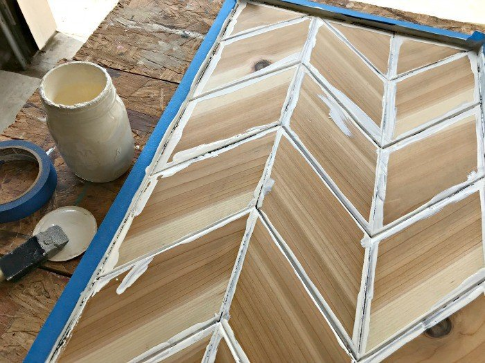 Here's a cool tutorial for DIY Chevron Wood Wall Art that I love! She used Cedar with accents of blue and white paint to add a chippy, distressed look. #AbbottsAtHome #WoodArt #WoodworkingIdea #DIYIdeas #Cedar #WallArt