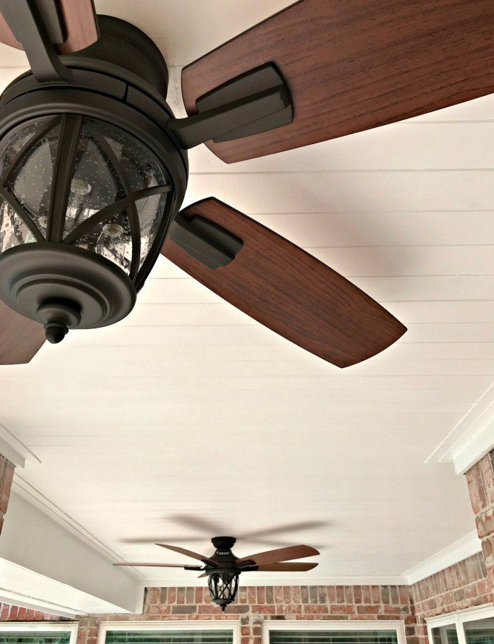 A DIY Pine Tongue and Groove Ceiling Tutorial that will turn your porch into that beautiful, charming spot you've always wanted. For most porches, you can have these wood planks installed in a weekend, guys! #AbbottsAtHome #PlankCeiling #PorchCeiling #TongueAndGroove