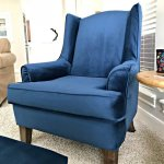 A few tips, DIY upholstery pictures, and my favorite tutorials to upholster a wingback chair. I'm so glad I gave this wingchair a makeover and it doesn't require any fancy sewing skills, guys. Plus, I am loving that Blue Velvet fabric!! #AbbottsAtHome #Upholstery #DIYProjects #Reupholster #Wingback #Velvet