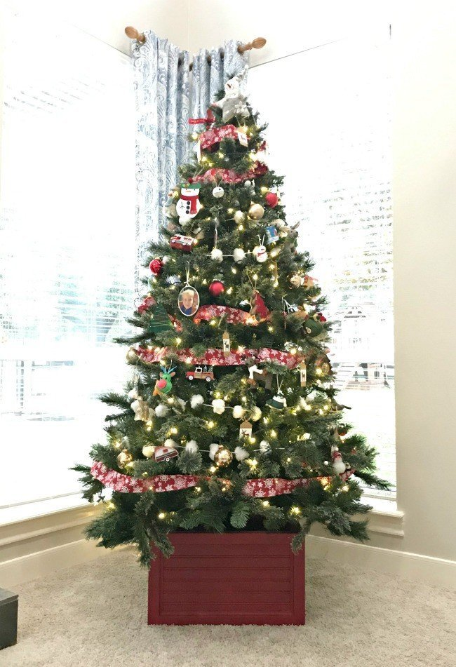 Build this easy DIY Christmas Tree Stand. Looks fantastic under your tree and stores your ornaments when you're ready to pack the tree away. #ChristmasTree #DIYFurniture #AbbottsAtHome #ChristmasTreeBox #ChristmasTreeStand #ChristmasTreeBoxStand