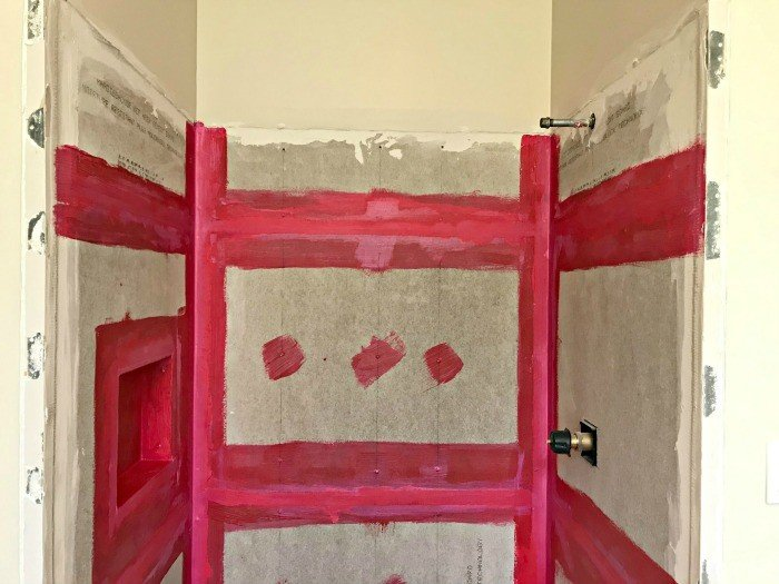 You can do this DIY Shower Niche Installation in less than an hour. This video shows you how easy it is! Plus, check out the bathroom after demo, with a framed in tub and shower prepped for tile. #BathroomRemodeling #BathroomMakeover #BathroomRemodel #ShowerNiche #Remodel #AbbottsAtHome