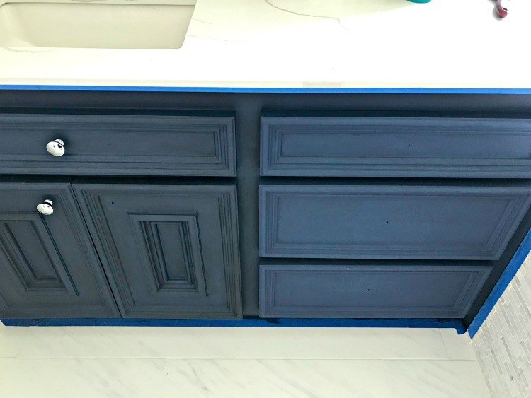 Napoleonic Blue Annie Sloan Chalk Paint with dark wax on the left side, clear wax on the right. DIY Napoleonic Blue Bathroom Vanity Makeover. #AbbottsAtHome #BathroomIdeas #HomeRemodeling #BathroomReno