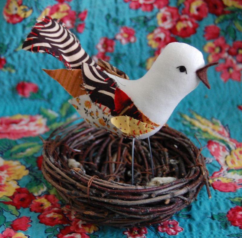 Fabric bird ornament in nest