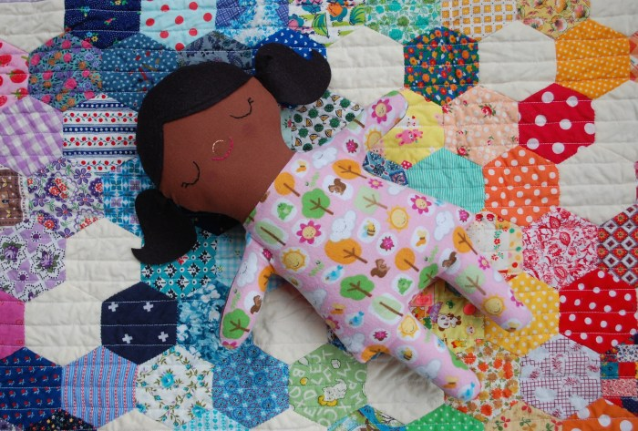 Doll on hexie doll quilt