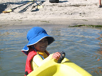 My older son pulling our kayak back to shore