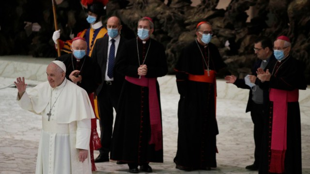 Pope Francis waves to faithful at the end of the weekly general audience in the Paul VI hall at the Vatican, Wednesday, Oct. 21, 2020. (AP Photo/Gregorio Borgia)