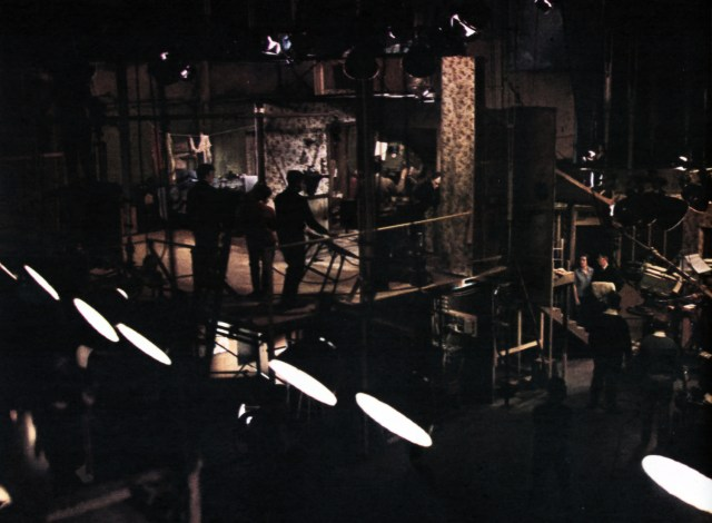 A cluster of lights hangs over the action; on a special two-tier section of another 'Avengers' set. The power for a production like this could keep a 100-watt bulb burning brightly for three-and-a-half years.