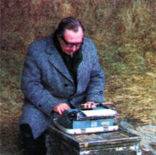 The producer - with a bale of hay and a packing case for office furniture - makes an alteration to the script. He has a keen knowledge of farming, but above all knows how to put it in visual terms for the farmer.