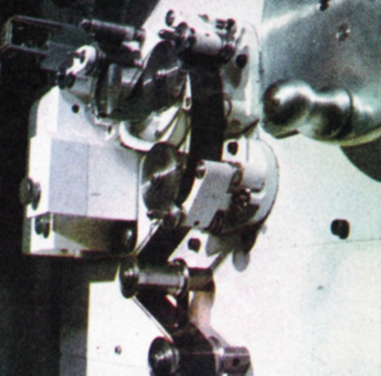 Close-up on the path of a filmed programme. A view of the sound reproducing head and part of the 35 mm film track in one of the three flying-spot telecine machines installed in the new technical block at Teddington.