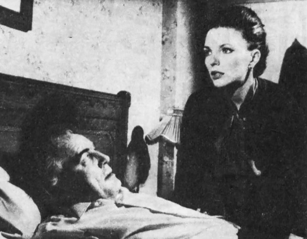 """Clifford Evans and Joan Collins in a scene from this week's story, """"Struggle for a Mind"""""""