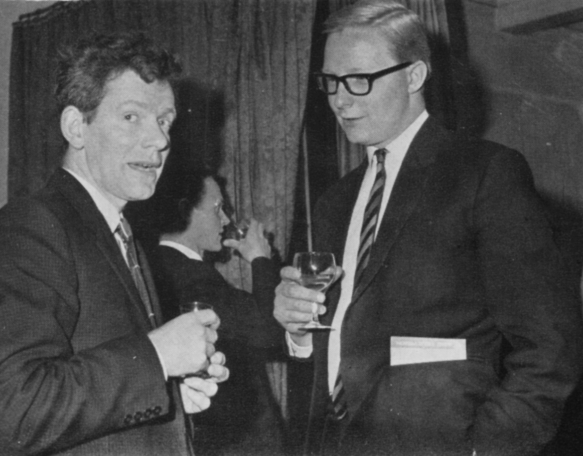 Two men with drinks in hand