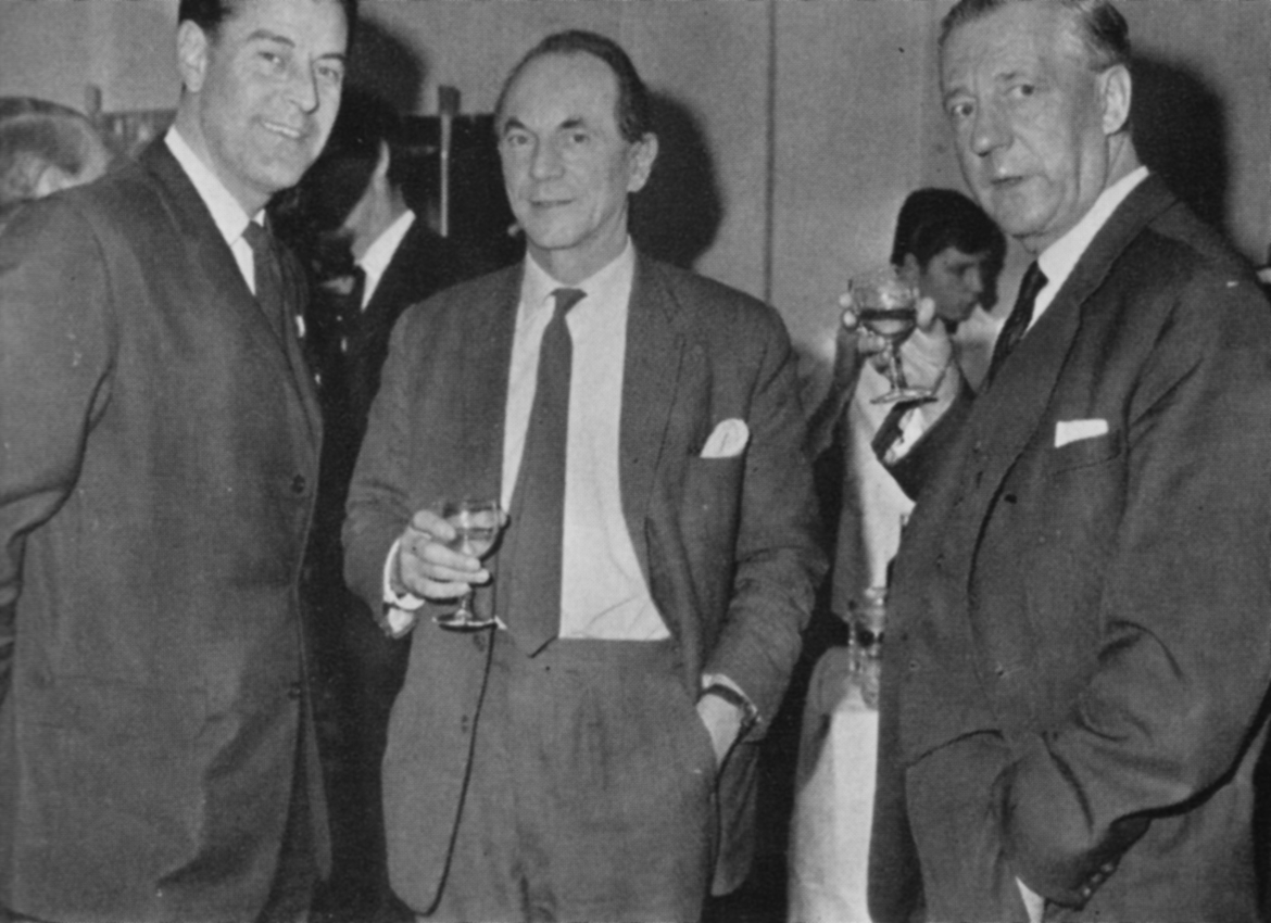 Three men with drinks in hand