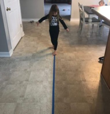 balance beam painters tape indoor activity