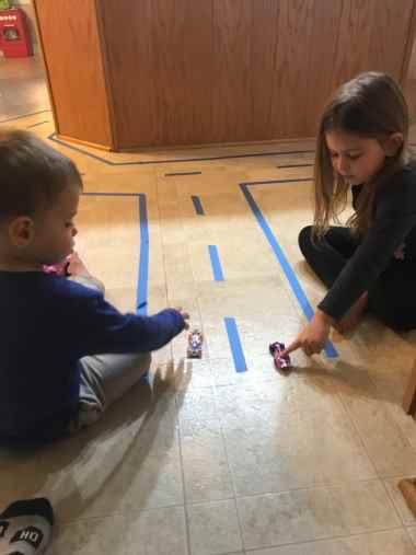 painters tape racetrack indoor kids activity
