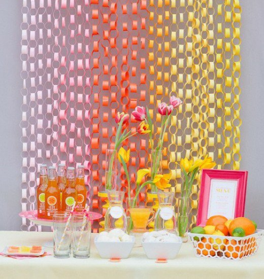 Paper chains decor in front of table of food