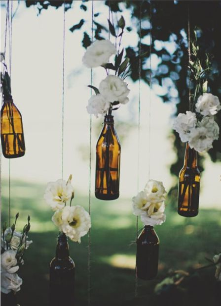 flowers coming out of bottles decor - nature inspired events