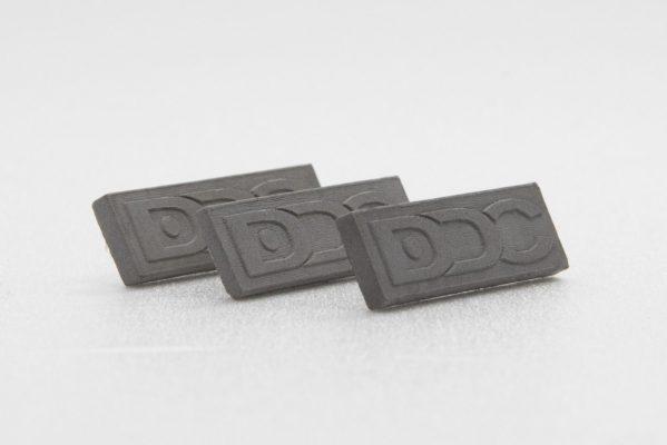 Custom made concrete pins for corporate uniformes