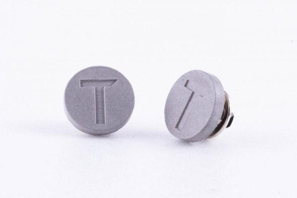 Branded concrete pins for construction company employees