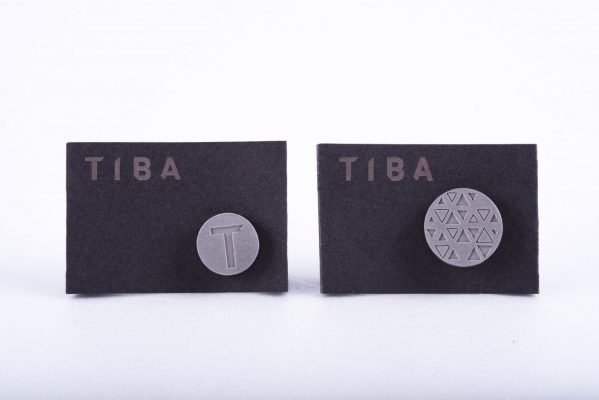 Custom made branded designer corporate gifts. Concrete pin for architecture studio employees