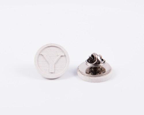 White concrete pins custom made design for university