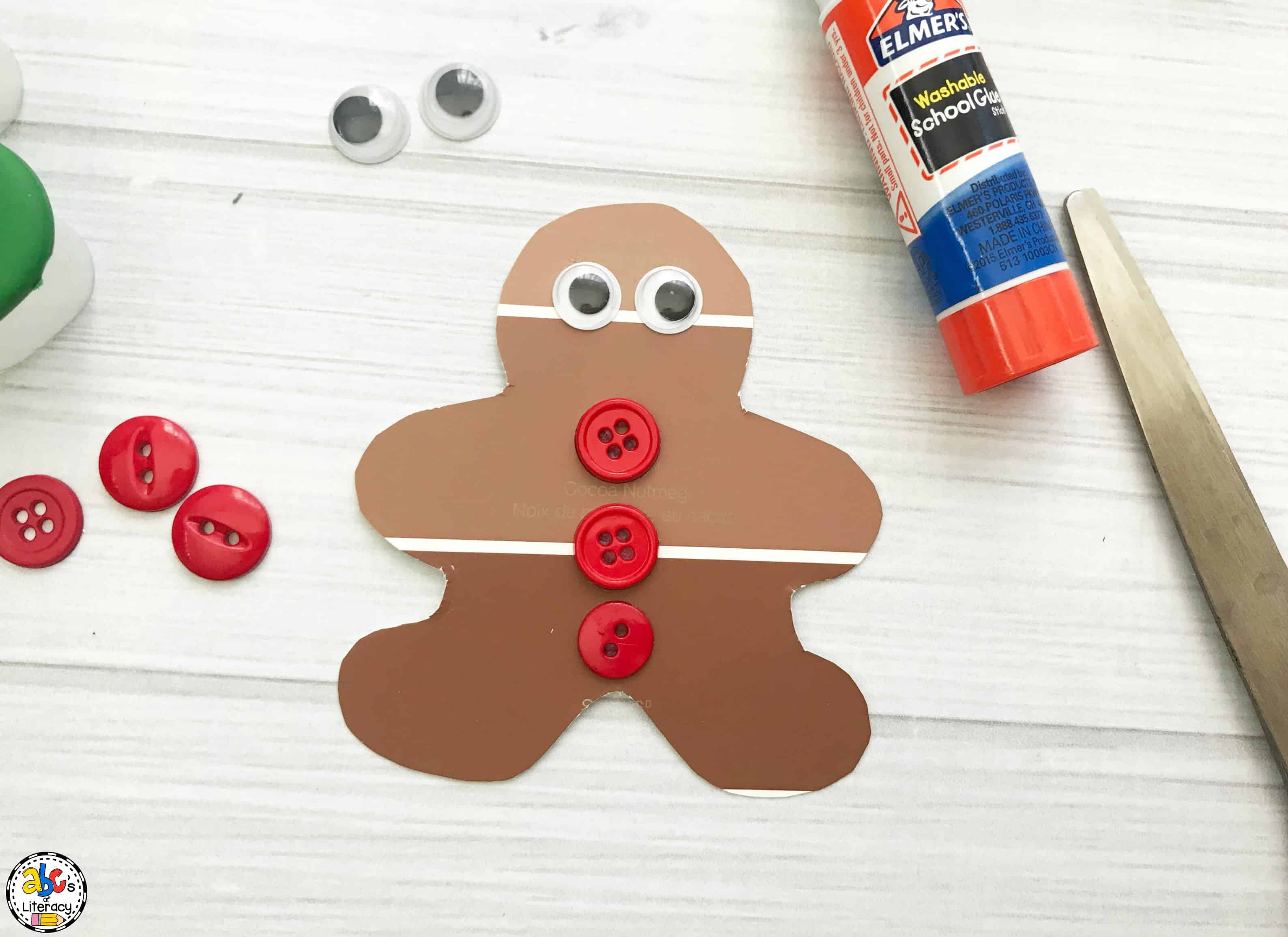 putting the eyes and buttons onto the gingerbread craft