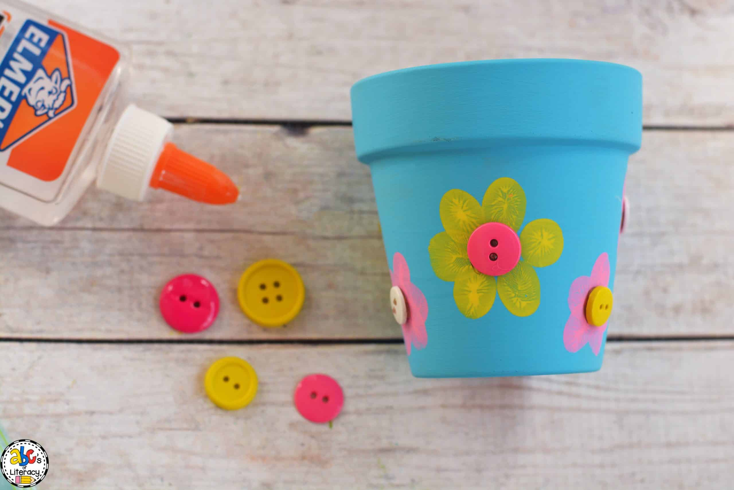 Glue Buttons on the Fingerprint Flowerpot Craft