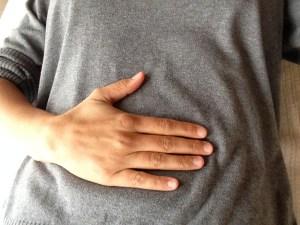 hand on abdomen