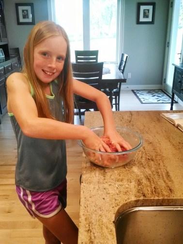 Grace mixing meatballs