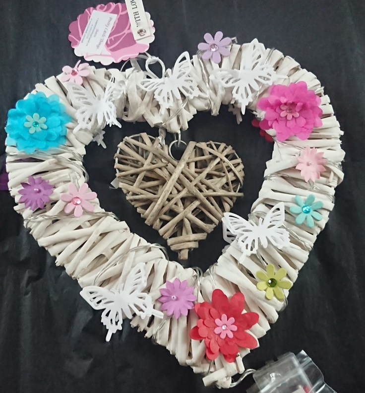 Unlit white heart with paper decorations